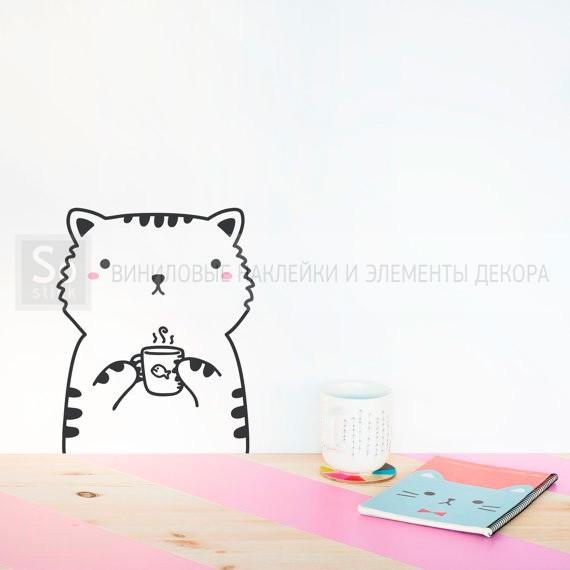 Котенок с чашкой